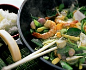 Wok with steaming stir-fried vegetables and shrimps