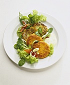 Vegetable burgers with chive and yoghurt sauce and salad
