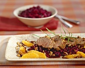 Venison fillet with hazelnut crust on red cabbage with oranges