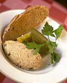 Duck rillettes, pieces of pickled gherkins and bread