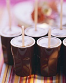Brown mugs of latte macchiato and straws