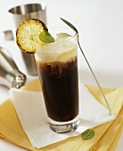 Cuban coffee with rum and lime in glass