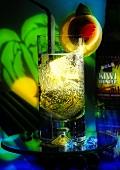Sparkling kiwi fruit and lemon drink in long drink glass