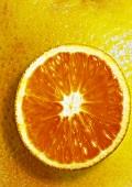 Slice of orange, background: orange peel