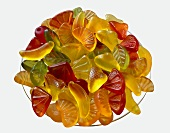 Bowl of wine gums on white background