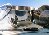 Still life with stew pot, soup ladle, knife and sieve