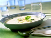Potato soup with spring onions and slivered almonds