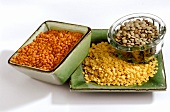 Red, brown and yellow lentils in bowls