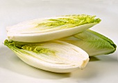 One whole and one halved chicory