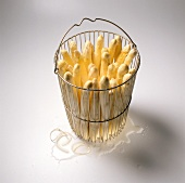White asparagus in basket insert