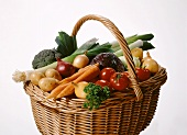 Raffia basket of assorted vegetables and parsley