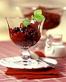 Red fruit compote in a glass bowl