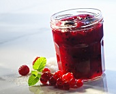Redcurrant & raspberry preserve with berries & sugar