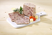 Home-made ham sausage (Bierschinken)on a chopping board