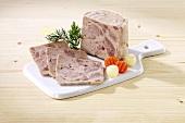 Home-made ham sausage (Bierschinken)on a chopping board