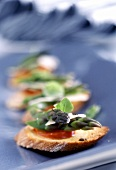 Crostini (Toasted bread with green asparagus and tomatoes)