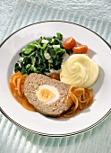 Mock hare (meatloaf) with onion sauce, chard, mashed potato