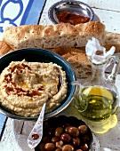 Chick-pea puree (hummus) pita bread and olives (Arabia)