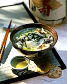 Japanese miso soup with tofu, radish and mushrooms