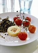 Barbecued goat's cheese & cocktail tomatoes with lentils