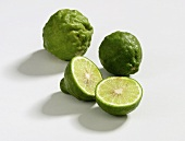 Two whole and one halved kafir limes