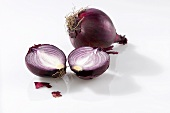 One whole and one halved red onion