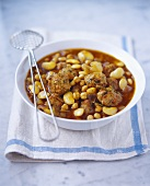 White bean stew with lamb meatballs