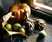 Pears, artichokes and pumpkin on window-sill