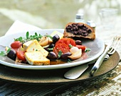 Smoked tofu with tomatoes and olives; bread with tapenade