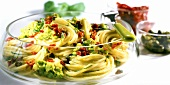 Spaghetti with avocado puree and dried tomatoes