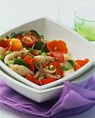 Squid and tomato salad with nasturtium flowers