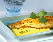 Fried red snapper in saffron cream sauce with lovage