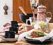 Steak burger and potato on laid table
