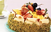 Cream cake with fruit and marzipan coating