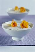Cauliflower & gorgonzola soup decorated with nasturtium flowers