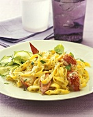 Tagliatelle with lobster, cream sauce and cucumber salad