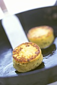 Frying potato cakes (made from potato pancakes) in pan