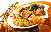 Pepper and shrimp kebabs with spicy mango salad