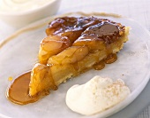 Piece of tarte tatin (caramelised apple tart) & cinnamon cream