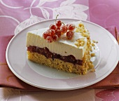 A piece of redcurrant yoghurt cake with peanuts