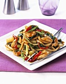 Fried Chinese egg noodles with vegetables and turkey
