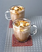 Hot chocolate with cream and pieces of caramel