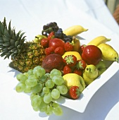 Fresh fruit and grapes in a bowl