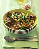Lamb ragout with chili, garlic, green and white beans