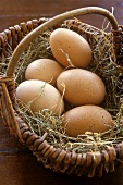 Brown hen's eggs in a basket