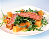 Entrecote on rocket with diced pumpkin