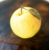 Golden Delicious apple with leaf