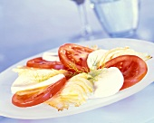 Tomatoes with mozzarella and wedges of fennel