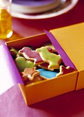 Colourful iced butter biscuits in a gift box