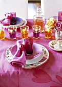 Festive table in violet and orange with gel candles